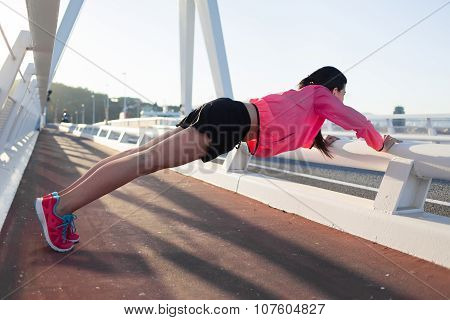 Athletic female engaged in physical activity outside during her recreation time