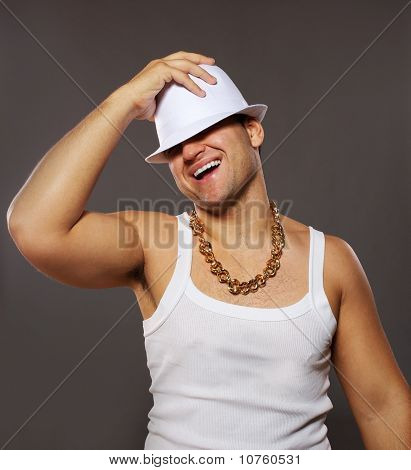 Stylish man holding white hat