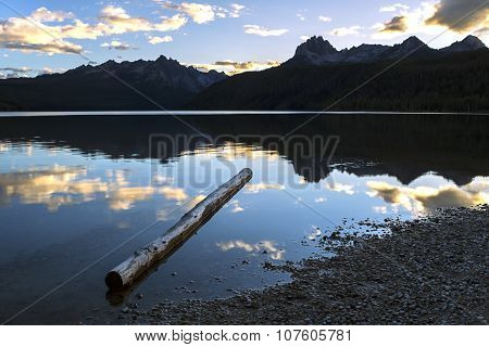 Log In Lake At Sunset.