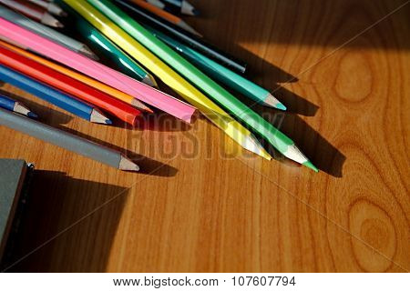 Many color pencils on the desk