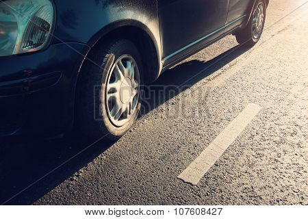 car tires on asphalt road