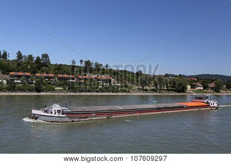 Barge floats on the river