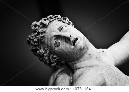 Ancient style sculpture of The Rape of the Sabine Women in Loggia dei Lanzi in Florence, Italy. Black and white, head close-up