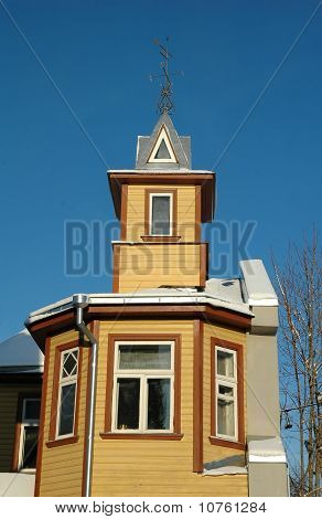 Yellow Wooden House With Weathercock