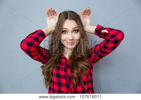 Funny curly comic girl in plaid shirt posing and having fun