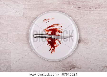 Knife On White Plate With Blood