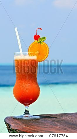 Glass Of Drink Is On A Beach Table