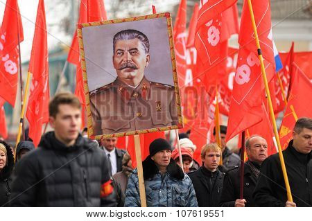 Orel, Russia - November 7, 2015: Communist Party Meeting. Stalin Portrait, Red Flags, People Marchin