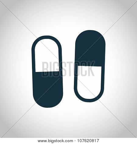 Two capsules flat icon
