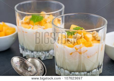 Pure Semolina Pudding With Fresh Mango And Mint Leaves