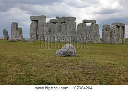 Stonehenge Historic Site On Green Grass Under Blue Sky. Stonehenge Is A Unesco World Heritage Site I
