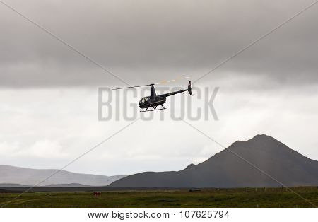 MORDALUR, ICELAND - AUGUST 31, 2015: Helicopter for medical help at remote Mordalur farm