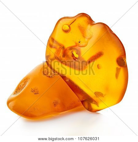Pieces Of Amber Close-up Isolated On A White Background.