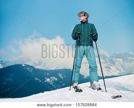 Ski Instructor Young Man On The Top Of Snow Hill