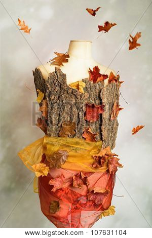 Close up of autumn mannequin with falling leaves
