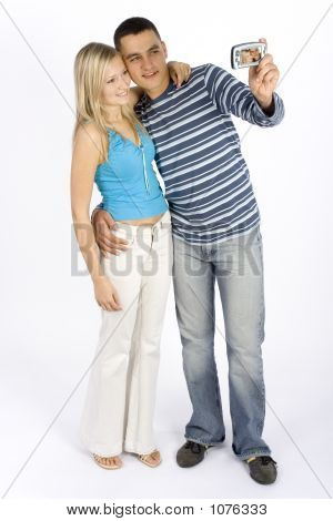 Young Couple Taking Picture By Phone/Palmtop