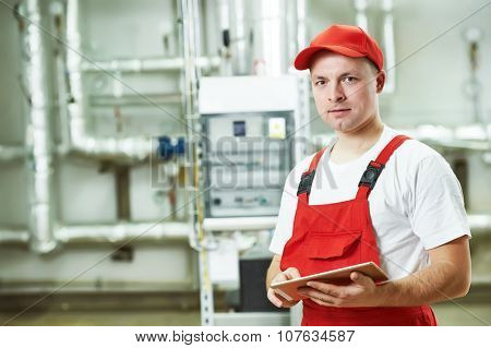 Technician maintenance repairman engineer inspector in heating system of boiler room