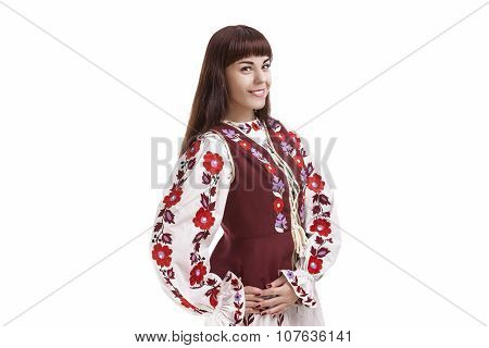 Traditions Concept. Caucasian Brunette Woman In Flowery Hand-made Unique Dress