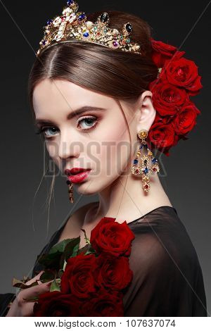 Fashion girl portrait with red roses.Accessorys.Grey background