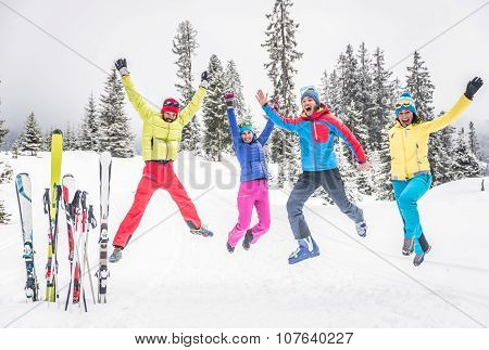 Group Of Skiers Jumping And Having Fun