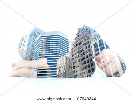 Double exposure portrait of a young woman performing yoga asana, combined with photograph of a downtown buildings