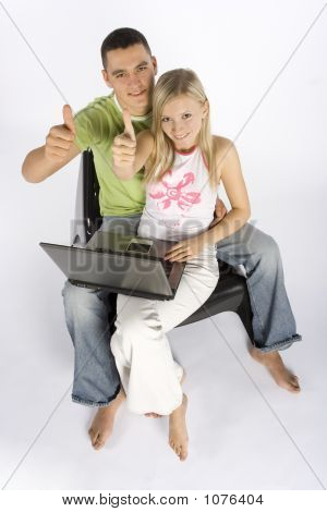 Young Couple With Laptop Showing Ok