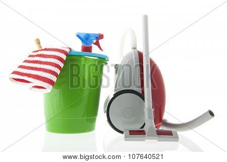 Green bucket and red vacuum cleaner isolated over white background