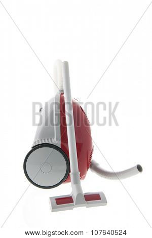 Red vacuum cleaner isolated over white background