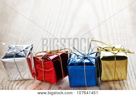 Small gift boxes on wooden background macro close-up