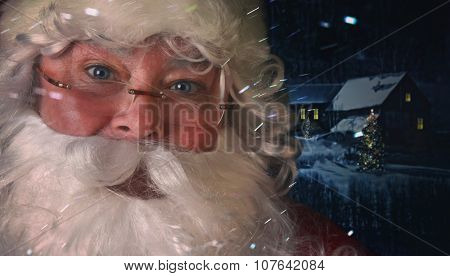Closeup of Santa Claus with night time scene in background