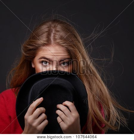 Woman Hides Her Face Behind A Hat. Flirty.