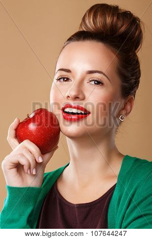 Girl With A Clean Skin Holding A Red Apple.