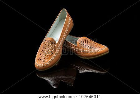 Orange women loafer isolated on black background