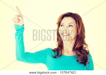 Beautiful woman making choose on abstract screen.
