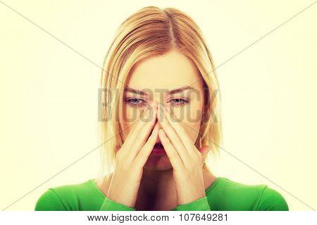 Beautiful woman suffering from sinus pain.
