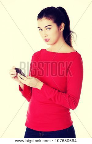 Young woman useing a modern mobile.