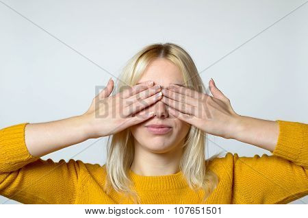 Woman Covering Her Eyes With Bare Hands