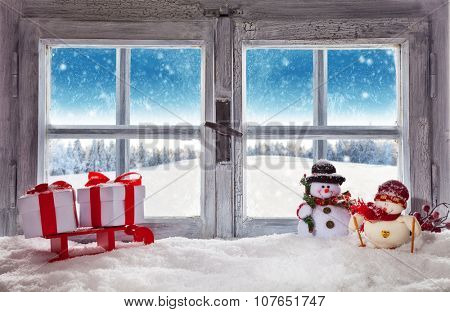 Vintage wooden window overlook winter landscape, shot from cottage interior