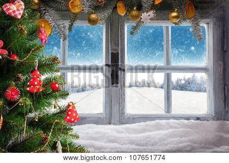 Vintage wooden window overlook winter landscape. Christmas tree on foreground