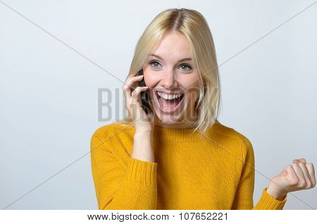 Happy Woman Talking To Someone Over The Phone