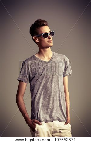 Handsome guy wearing sunglasses outdoor. Vacation day. Men's beauty, fashion.