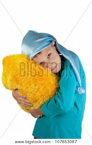 Boy In Pajamas Holding Pillow Isolated On White