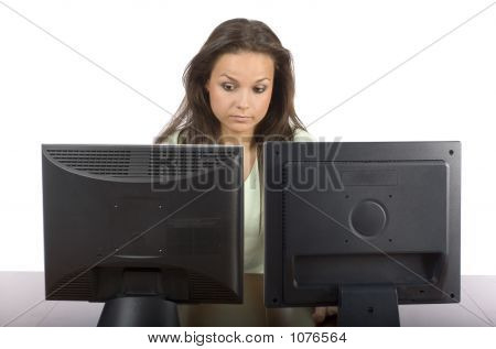 Woman At The Two Lcd Screens