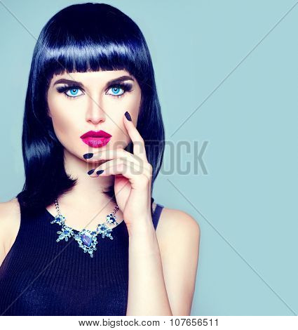 High Fashion Model Girl Portrait with Trendy fringe Hair style, Make up and Manicure. Black Hairstyle, Black Nail Polish and purple Lipstick. Woman Makeup. Sexy Lips. Bob Haircut