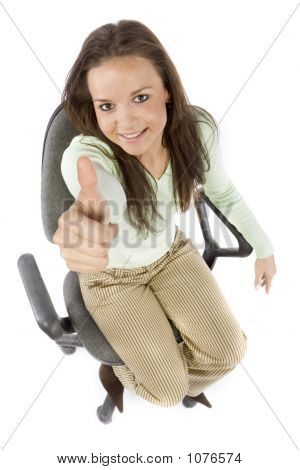Woman Sitting On The Office Chair, Showing Ok