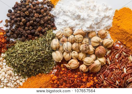 Spices For Heath And Cooking On Background.