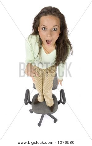 Terrified Woman Standing On The Office Chair