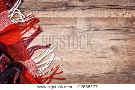 checkered plaid on wooden background
