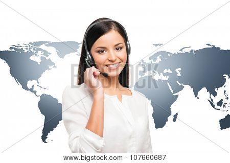 Young, confident and beautiful customer support operator. Worldwide call center concept.