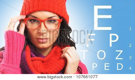 Beautiful girl wearing glasses checking her eyes in winter time.
